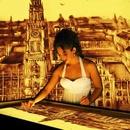 München – Weltstadt mit Herz in Sand gemalt
